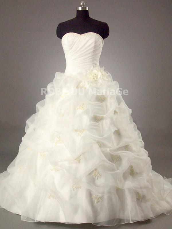 Robe de mariée romantique bustier bouffante fleurs perles organza